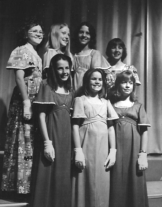 "Lynnette Owens (bottom row, far right) sings with the ""Hummingbirds"" in 1976"