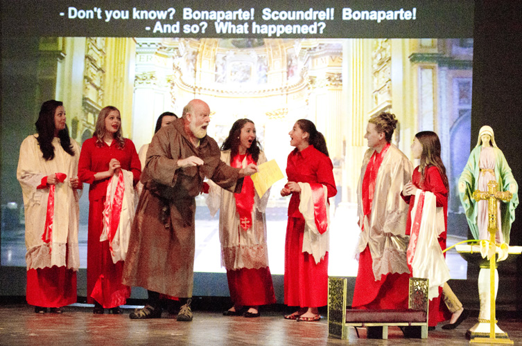 "Lyrical Opera Theater's ""Tosca"" Act 1, William Goeglein as Sagrestano and Holly Anderson, River Lundskog, Carolyn King, Arielle Tholen, Alexa Givens, Deborah Siddoway and Jamie Forchic as Choir Singers ""Bonaparte!...scellerato!"""