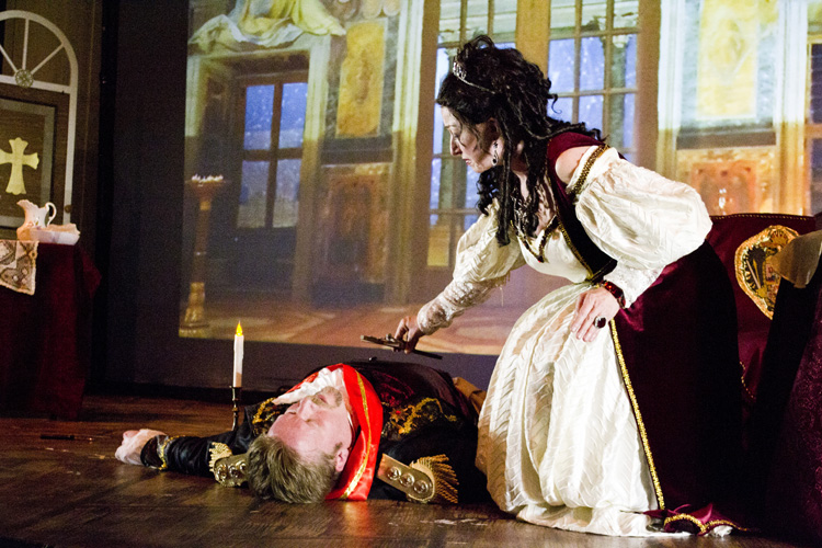 "Lyrical Opera Theater's ""Tosca"" Act 2, Lynnette Owens as Tosca and Tyler Oliphant as Scarpia ""Tosca places the cross."""